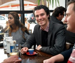 Tim Watts, centre, celebrates his victory at a cafe in Seddon on Sunday. 105388 Picture: JOE MASTROIANNI