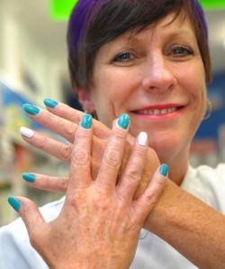 Staff at the Altona North Chemmart Pharmacy including Denise are preparing to paint the town teal for Ovarian Cancer Awareness Month this February 114335 Picture: JOE MASTROIANNI