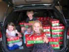 Hayley Blackwell, Eliza Payne, Willis and Harvey Jensen with the Christmas packages.